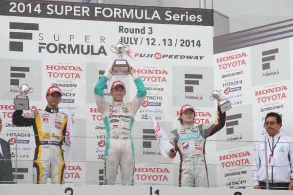 2014 Super Formula Series. Fuji, Japan. 11th - 13th July 2014. Rd 3. Winner Kazuki Nakajima ( #37 TEAM TOM'S SF14 ) 2nd position Ryo Hirakawa ( #7 ACHIEVEMENT Team KYGNUS SUNOCO SF14 ) 3rd position, Yuji Kunimoto ( #39 P.MU / CERUMO?INGING SF14 ), podium, portrait. World Copyright: Yasushi Ishihara / LAT Photographic. Ref: 2014SF_Rd3_013.JPG