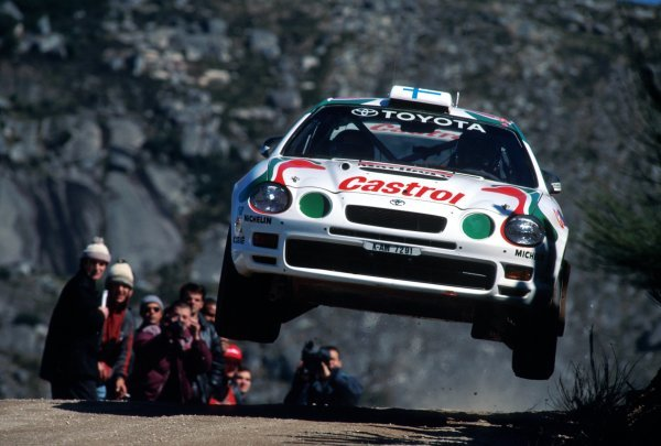 Juha Kankkunen (FIN) Toyota Celica GT-Four with co-driver Nicky Grist (GBR) flies through the air en route to a 2nd place finish. World Rally Championship, Rally Portugal, 7-10 March 1995.