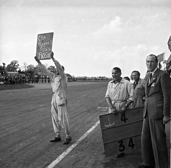 1949 British Grand Prix.Silverstone, Great Britain. 14 May 1949.Having retired from the race Louis Chiron, Ecurie France Lago-Talbot T26C, shows the pit board to his team mate, pitlane action.World Copyright: LAT PhotographicRef: Autocar glass negative