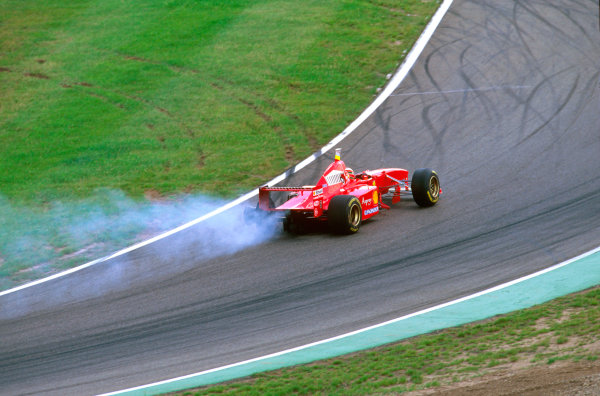 Hockenheim, Germany.25-27 July 1997.Eddie Irvine (Ferrari F310B) with a puncture after a collision with Frentzen on lap 1.Ref-97 GER 07.World Copyright - LAT Photographic