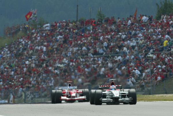 2003 European Grand Prix - Sunday RaceNurburgring, Germany.29th June 2003.Jenson Button, B-A-R Honda 005, leads Olivier Panis, Toyota TF103, action.World Copyright LAT Photographic.Digital Image Only.