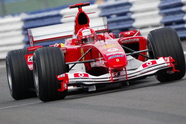 2004 British Grand Prix - Friday Practice, Silverstone, Britain. 09th July 2004 Michael Schumacher, Ferrari F2004, action.World Copyright: Steve Etherington/LAT Photographic ref: Digital Image Only