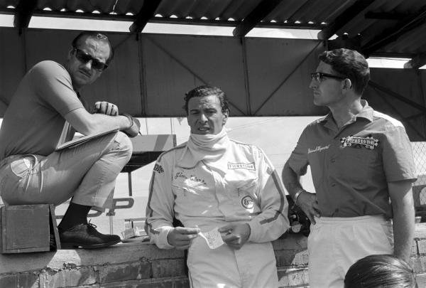 (L to R): Lotus team owner Colin Chapman; race winner Jim Clark (GBR); Brian Hayward, Firestone tyre engineer.   South African Grand Prix, Kyalami, South Africa, 1 January 1968.