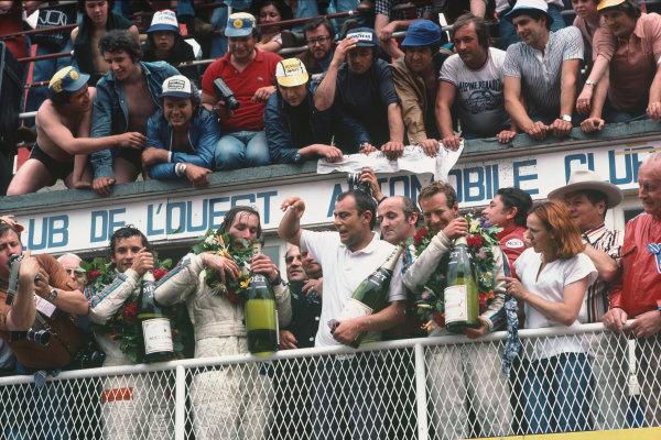 Le Mans, France. 11th - 12th June 1977 Jurgen Barth/Hurley Haywood/Jacky Ickx (Porsche 936/77), 1st position, podium, portrait. World Copyright: LAT PhotographicRef: 77LM08.