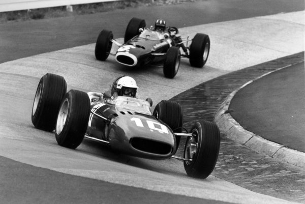 1966 German Grand Prix.Nurburgring, Germany. 7 August 1966.Michael Parkes, Ferrari 312, retired, leads Graham Hill, BRM P261, 4th position, action.World Copyright: LAT PhotographicRef: L66/534 #2A
