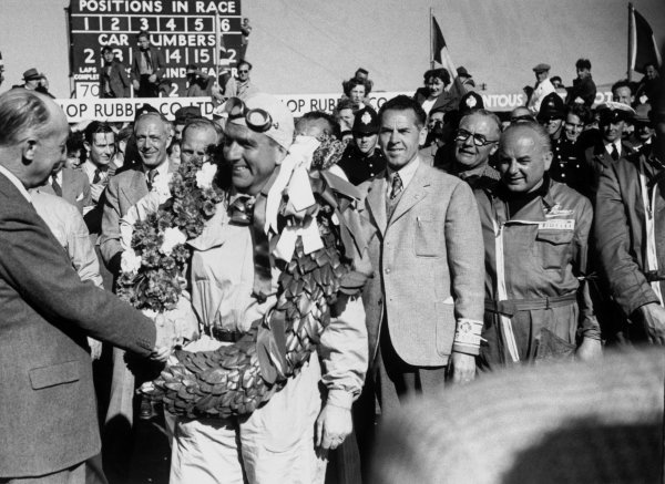 1950 British Grand Prix. Silverstone, England. 11th - 13th  May 1950. Giuseppe Farina (Alfa Romeo 158) 1st position, on the podium after winning the first ever World Championship Grand Prix. World Copyright - LAT Photographic.