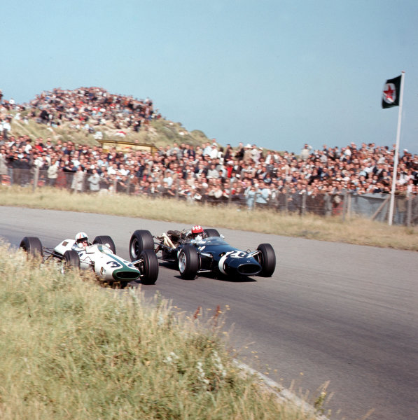 Zandvoort, Holland.24 July 1966.Mike Spence (Lotus 25 BRM, number 32) and Jo Siffert (Cooper T81 Maserati) side-by-side. Spence finished in 5th position.Ref-3/2310.World Copyright - LAT Photographic
