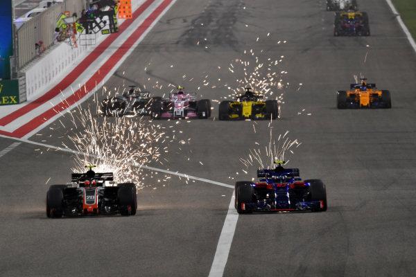 Romain Grosjean (FRA) Haas VF-18 and Pierre Gasly (FRA) Scuderia Toro Rosso STR13 battle