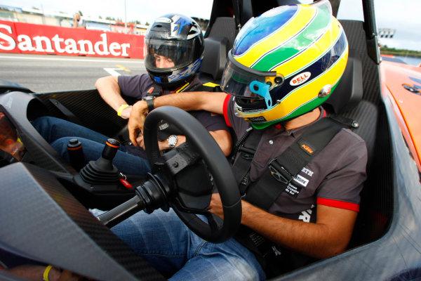 Hockenheimring, Hockenheim, Germany24th July 2010Bruno Senna, HRT F1 F110-02, gives a passenger ride in an X-Bow. Portrait. Helmets. Atmosphere.World Copyright: Charles Coates/LAT Photographicref: Digital Image _26Y4201