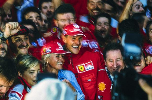 Michael Schumacher celebrates securing his third World Drivers Championship title with his wife Corrina, Ross Brawn, Technical Director, Ferrari, Jean Todt, Team Principal, Ferrari, and the Ferrari team.