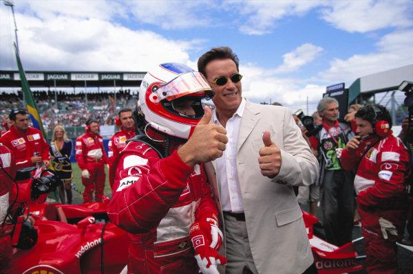 Rubens Barrichello with Arnold Schwarzenegger.