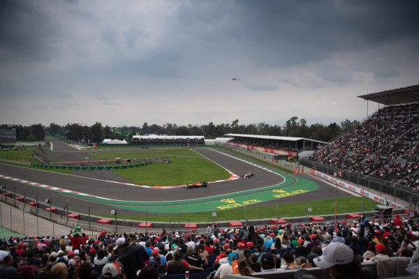 Carlos Sainz Jr., McLaren MCL34, leads Lance Stroll, Racing Point RP19