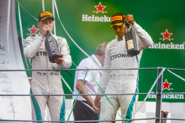 Valtteri Bottas, Mercedes AMG F1, 3rd position, and Lewis Hamilton, Mercedes AMG F1, 1st position, celebrate on the podium.