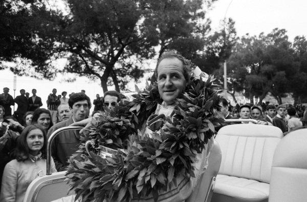 Race winner Denny Hulme on a parade after the podium ceremony.