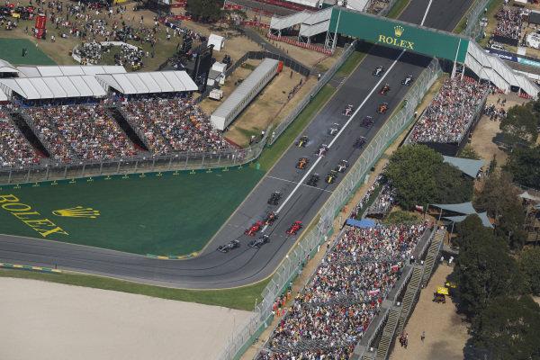 Valtteri Bottas, Mercedes AMG W10, leadsLewis Hamilton, Mercedes AMG F1 W10, Sebastian Vettel, Ferrari SF90, Max Verstappen, Red Bull Racing RB15, Charles Leclerc, Ferrari SF90, and the rest of the field into the first corner