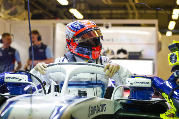 Robert Kubica, Williams Martini Racing, exits his cockpit in the team's garage.