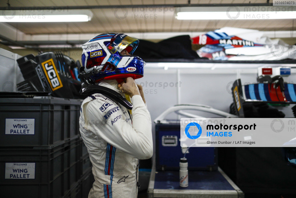 Sergey Sirotkin, Williams Racing, adjusts his crash helmet.