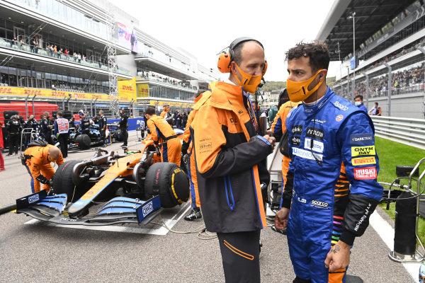 Daniel Ricciardo, McLaren, on the grid with his race engineer