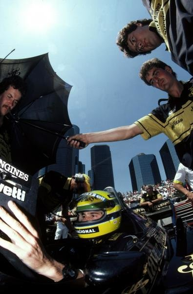 Pole sitter and race winner Ayrton Senna (BRA) Lotus 98T studies the timing monitors during qualifying