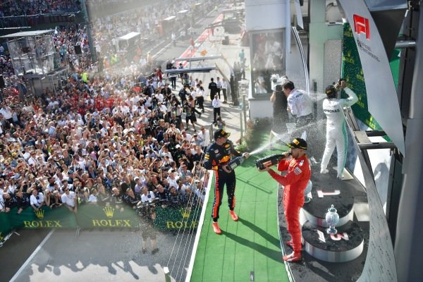 Max Verstappen, Red Bull Racing, 2nd position, sprays Champagne at Lewis Hamilton, Mercedes AMG F1, 1st position, and Sebastian Vettel, Ferrari, 3rd position, on the podium