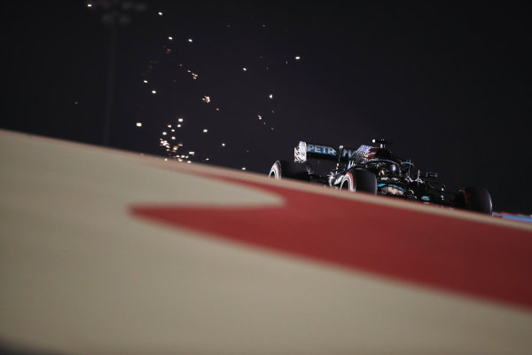 Sparks fly from the rear of Lewis Hamilton, Mercedes F1 W11 EQ Performance