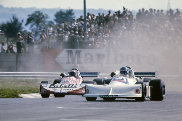Hans-Joachim Stuck, March 762 BMW/Rosche, leads Gaudenzio Mantova, March 762 BMW, and a cloud of dirt.