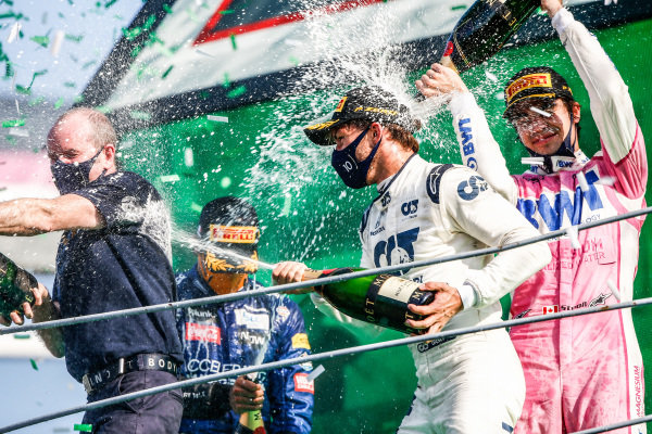 Carlos Sainz, McLaren, 2nd position, Pierre Gasly, AlphaTauri, 1st position, and Lance Stroll, Racing Point, 3rd position, celebrate with Champagne on the podium