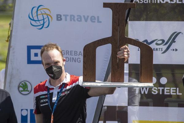 Jari-Matti Latvala of Toyota holds his winning constructors' trophy