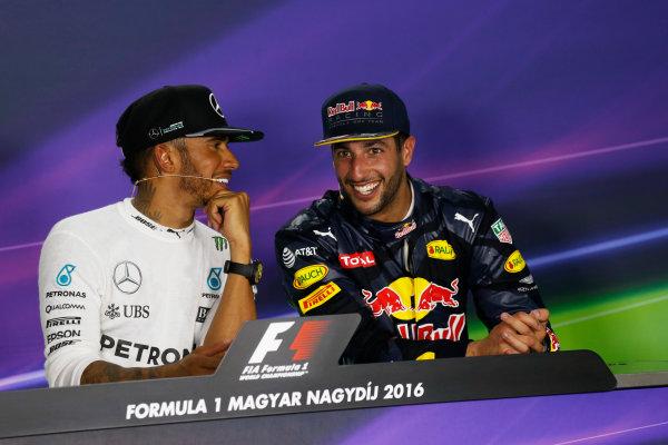Hungaroring, Budapest, Hungary. Sunday 24 July 2016. Lewis Hamilton, Mercedes AMG, 1st Position, and Daniel Ricciardo, Red Bull Racing, 3rd Position, joke in the Press Conference. World Copyright: Sam Bloxham/LAT Photographic ref: Digital Image _SBB9231