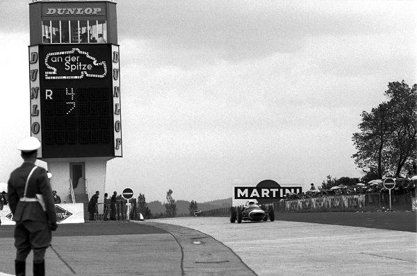 Race winner Stirling Moss (GBR), Lotus 18/21. German Grand Prix, Rd6, Nurburgring, Germany. 6 August 1961.