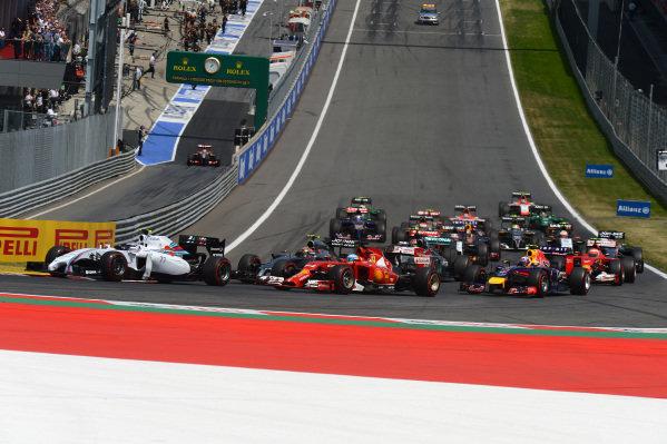 Valtteri Bottas (FIN) Williams FW36 and Fernando Alonso (ESP) Ferrari F14 T at the start of the race. Formula One World Championship, Rd8, Austrian Grand Prix, Race, Spielberg, Austria, Sunday 22 June 2014.