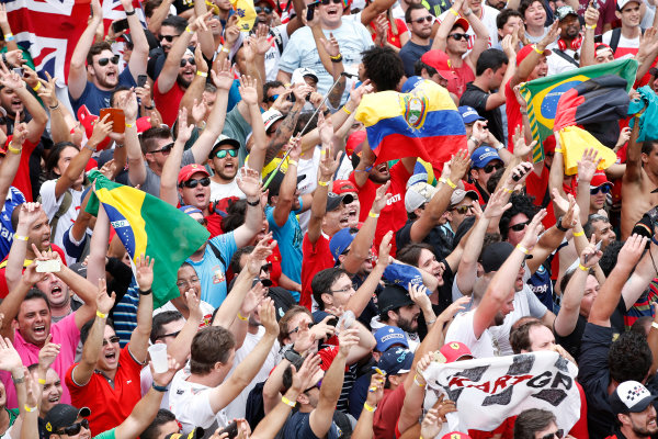 Interlagos, Sao Paulo, Brazil. Sunday 15 November 2015. The crowd cheer for the drivers on the podium. World Copyright: Glenn Dunbar/LAT Photographic ref: Digital Image _W2Q5827