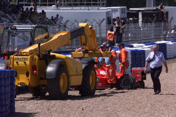 1999 British Grand Prix. Silverstone, England. 9th - 11th July 1999. Michael Schumacher (Ferrari F399), crashes heavily into the tyre barriers at Stowe on the first lap, breaking his leg. World Copyright: LAT Photographic.  Ref:  99_GB_MS_Crash_08.