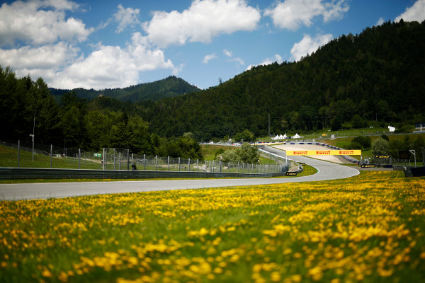 Red Bull Ring, Spielberg, Austria. Thursday 06 July 2017. A scenic view of the Red Bull Ring track, featuring yellow flowers on the verge. World Copyright: Andy Hone/LAT Images ref: Digital Image _ONZ8661