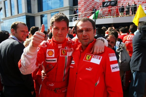 (L to R): Rob Smedley (GBR) Ferrari Race Engineer and Stefano Domenicali (ITA) Ferrari Manager of F1 Operations celebrate in parc ferme.