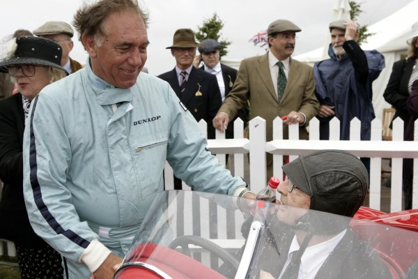 2006 Goodwood Revival Meeting. Goodwood, West Sussex. 2nd - 3rd September 2006 Rob Wilson says hello to friend Phil Hill.World Copyright: Gary Hawkins/LAT Photographic ref: Digital Image Only