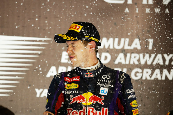 Yas Marina Circuit, Abu Dhabi, United Arab Emirates. Sunday 3rd November 2013. Sebastian Vettel, Red Bull Racing, 1st position, celebrates on the podium. World Copyright: Steven Tee/LAT Photographic. ref: Digital Image _L0U0678