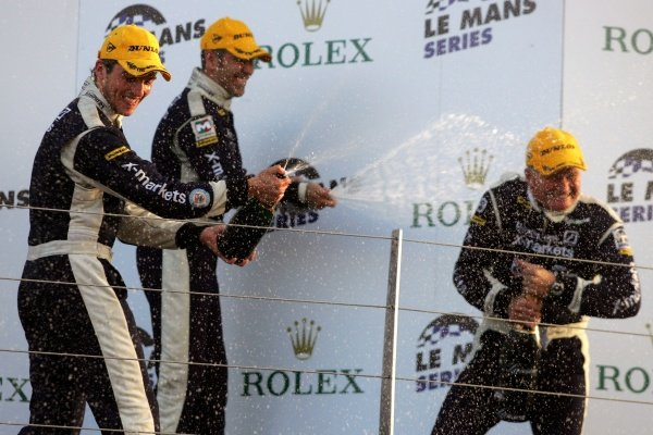 L-R: Stuart Hall (GBR) and Joao Barbosa (POR) spray champagne over Rollcentre Racing team owner/driver Martin Short (GBR). Le Mans Series, Rd 5, Silverstone, England. 16 September 2007.