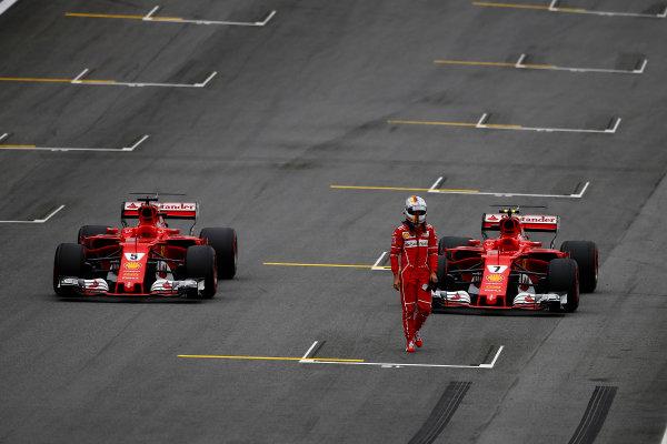 Interlagos, Sao Paulo, Brazil. Saturday 11 November 2017. Sebastian Vettel, Ferrari SF70H, and Kimi Raikkonen, Ferrari SF70H, mistakenly park their cars on the grid at the end of Qualifying. World Copyright: Andrew Hone/LAT Images  ref: Digital Image _ONZ5286