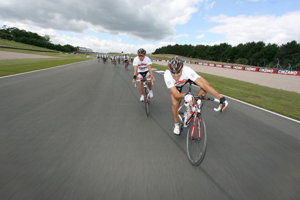 Donington Park, England. 18th June 2008.Preview Day.James Toselands cycle 2 laps of the track for Riders for Health.World Copyright: Martin Heath/ LAT Photographicref: Digital Image