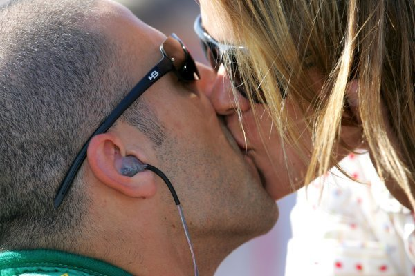 Tony Kanaan (BRA), Andretti Green Racing, gets a big kiss from his wife Loila before qualifying for the Toyota Indy 400. He went on to win the 2004 IndyCar series.