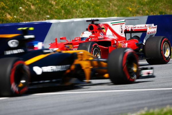 Red Bull Ring, Spielberg, Austria. Friday 07 July 2017. Sebastian Vettel, Ferrari SF70H, spins in FP1 in front of Jolyon Palmer, Renault R.S.17.  World Copyright: Andy Hone/LAT Images ref: Digital Image _ONZ9194