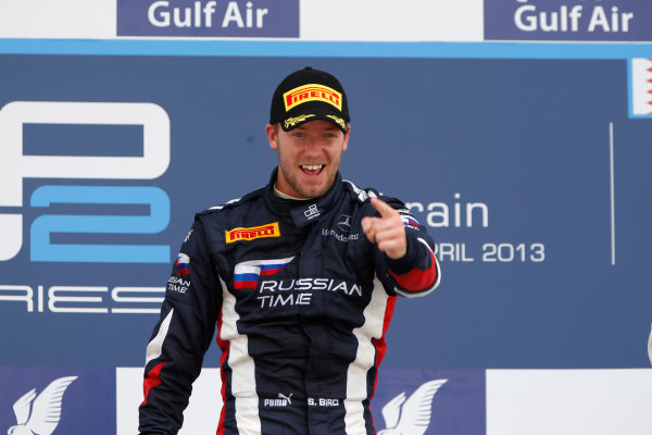 2013 GP2 Series. Round 2.  Bahrain International Circuit, Sakhir, Bahrain. 21st April.  Sunday Race.  Sam Bird (GBR, RUSSIAN TIME) celebrates his victory on the podium.  World Copyright: Glenn Dunbar/GP2 Series Media Service. Ref: _89P4321
