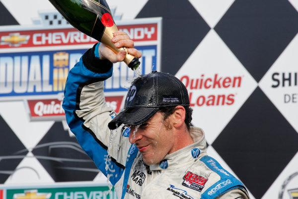 2 June, 2013, Detroit, Michigan, USA Winner Simon Pagenaud celebrates with champagne. ©2013, Todd Davis LAT Photo USA