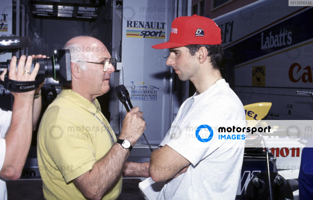 Monte Carlo, Monaco. 20 - 23 May 1993.Damon Hill (Williams FW15C Renault) 2nd position, is interviewed by Murray Walker for the BBC, portrait. World Copyright: LAT PhotographicRef: 93MON