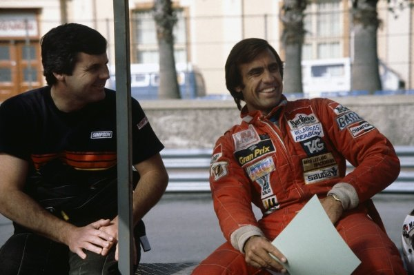 1981 Brazilian Grand Prix.Jacarepagua, Rio de Janeiro, Brazil. 27-29 March 1981.Carlos Reutemann (Williams FW07C-Ford Cosworth), 1st position, talks with team mate Alan Jones (Williams FW07C-Ford Cosworth), 2nd position. portrait.World Copyright: LAT PhotographicRef: 35mm transparency
