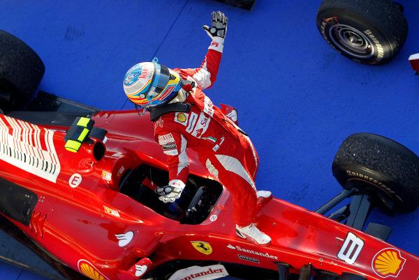Bahrain International Circuit, Sakhir, Bahrain14th March 2010Fernando Alonso, Ferrari F10, 1st position, arrives in Parc Ferme. Portrait. Helmets. Finish.World Copyright: Steven Tee/LAT Photographicref: Digital Image _A8C5581