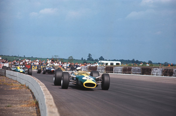 Silverstone, England. 13th - 15th July 1967. Jim Clark leads Graham Hill (both Lotus 49-Ford) and Chris Irwin (BRM P261), action.Ref: 67 GB 02 World Copyright: LAT Photographic