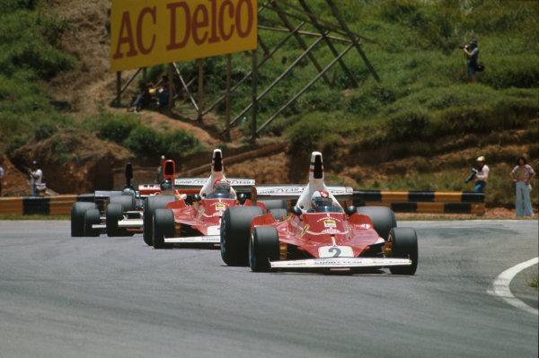 Interlagos, Sao Paulo, Brazil. 23-25 January 1976. Clay Regazzoni, leads Niki Lauda, both Ferrari 312T, James Hunt, McLaren M23 Ford, and Jean-Pierre Jarier, Shadow DN5B Ford. Ref: 76BRA17. World Copyright - LAT Photographic