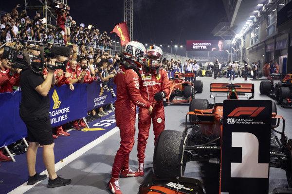 Sebastian Vettel, Ferrari, 1st position, celebrates in Parc Ferme with team mate Charles Leclerc, Ferrari, 2nd position